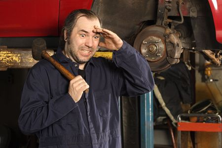 A crazy mechanic confused on what to do to fix the car. Stock Photo - 7491292