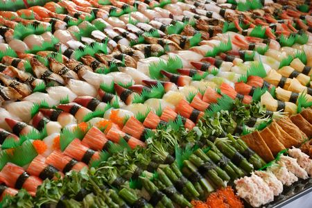 Photo of fresh sushi platter with a lot of variety. Selective focus on middle of the platter. photo
