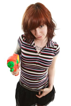 Photo of a beautiful redhead about to shoot a water gun. photo