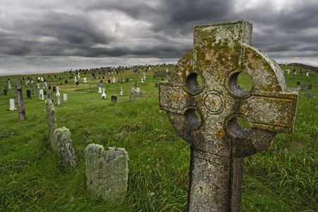 gravesite: Old Celtic gravesite with unmarked gravestones from the 1600s in the middle of a meadow in rural Scotland.
