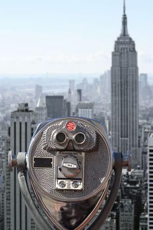 Photo of binoculars pointed at downtown Manhattan. photo