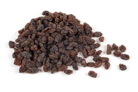 Photo of a pile of raisins on a white background.