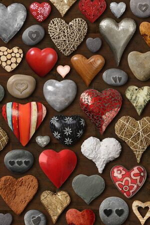 Background of heart-shaped things made of stone, metal and wood. photo