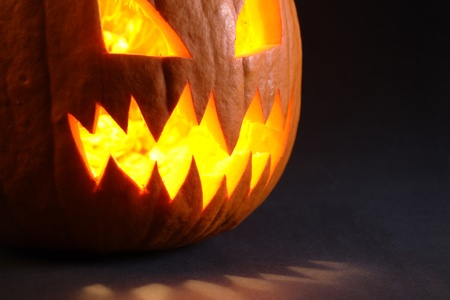 Photo of an angry pumpkin illuminated by a candle inside. Stock Photo - 8721343