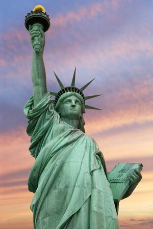 statue of liberty: Photo of the Statue of Liberty in New York City under a vivid sky. Stock Photo