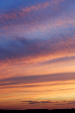 disappears: beautiful dramatic sky as the sun disappears below the horizon. Stock Photo
