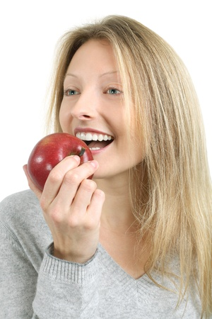 Photo of a beautiful blond woman biting into a red juicy apple. Stock Photo - 8821991