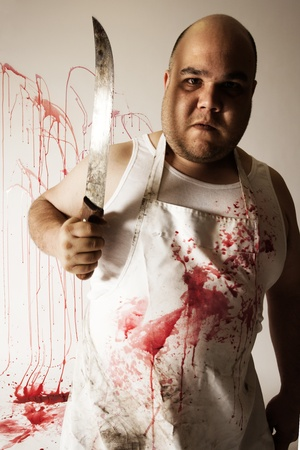 harsh: Crazy insane butcher covered with blood.  Harsh lighting for more disturbing feel.