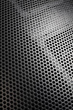 loudspeaker: Photo of a loudspeaker grill as a background.  Selective focus through the middle.
