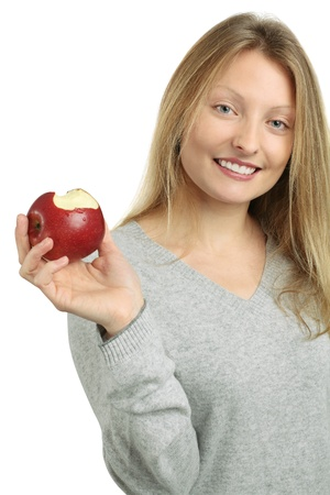 Photo of a beautiful blond woman holding a red juicy apple after she has taken a bite. Stock Photo - 8822003