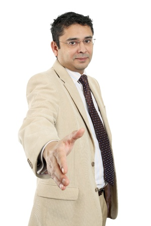 late thirties: An attractive Indian businessman in his late thirties extending his hand out.