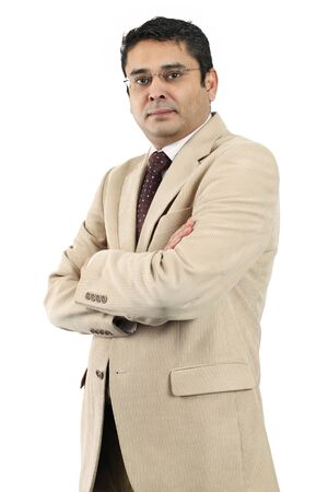 indian adult: A confident attractive Indian businessman in his late thirties with his arms crossed. Stock Photo