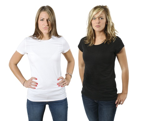 Angry young women posing with blank white and black shirts. Ready for your design or logo. photo