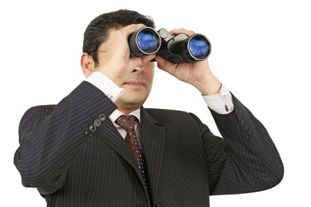 An Indian businessman in his late thirties looking through binoculars. photo