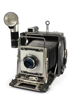 old photo: Photo of an antique 4x6-inch camera isolated on white background. Slight shadow visible around bottom of camera.