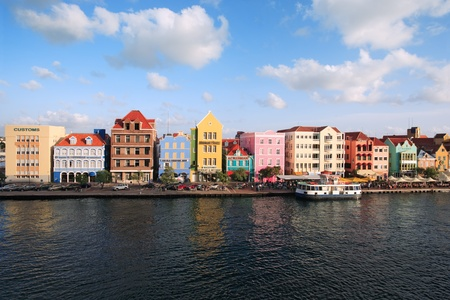 curacao: Willemstad, Curacao, Netherlands Antilles - October 15, 2010: Colourful houses and commercial buildings of Punda, Willemstad Harbor, on the island of Curacao, Netherlands Antilles.