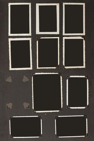hintergr�nde: Altes Fotoalbum mit leeren Fotos mit Ecken und Klebeband befestigt.