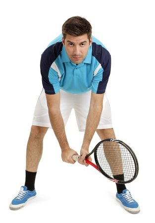 Photo of an attractive male tennis player waiting for the serve.  Full body shot with slight shadow around shoes. Stock Photo - 10504279