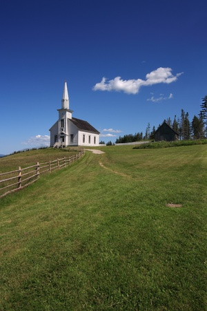 country landscape: Photo of a little white wooden church in the countryside.