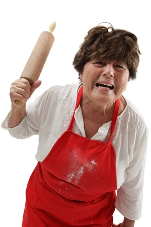 Photo of an old woman angry and threatening with a rolling pin. Stock Photo - 10862598