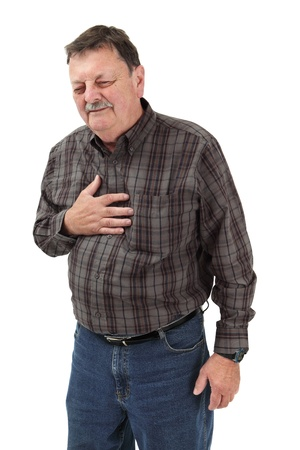 heartburn: Photo of a man in his sixties suffering pain from a heart attack or severe indigestion.
