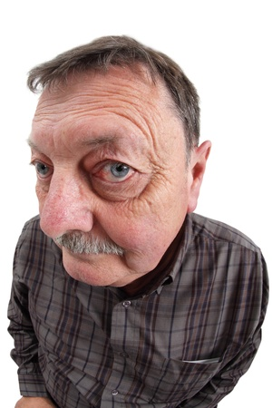 exaggerate: Photo of a man in his sixties using a fisheye lens to exaggerate his features.