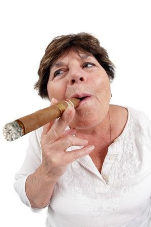 Photo of a woman in her sixties happily smoking a large cuban cigar. Taken with a fisheye lens. photo