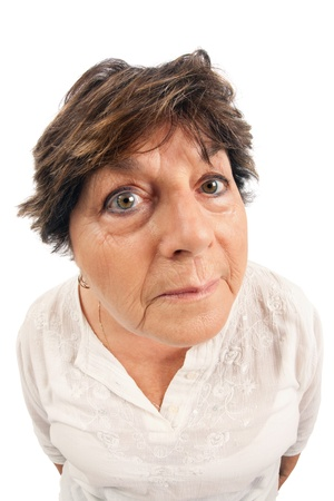 Close-up of woman standing over white background.  Shot with fisheye lens. photo