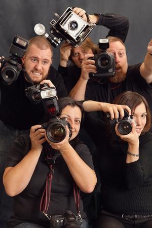 paparazzi: Photo of paparazzi fighting for space to take photos. Stock Photo