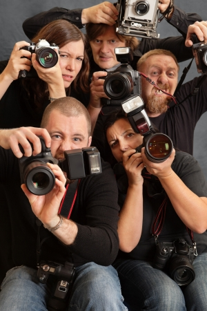 Photo of paparazzi fighting for space to take photos. Focus is on the face of the male in front. Stock Photo - 11312926
