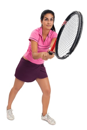 Photo of a young woman playing tennis over white background. photo