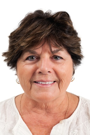 Close-up portrait of smiling senior woman over white background. photo