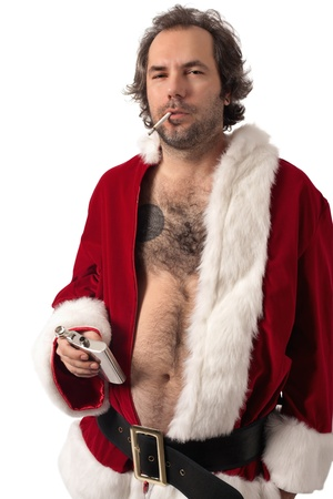 Photo of middle-aged adult man dressed in Santa clothes, smoking and holding alcohol flask. photo