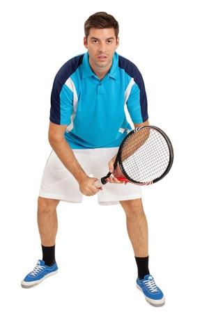 Photo of a young man playing tennis over white background. photo