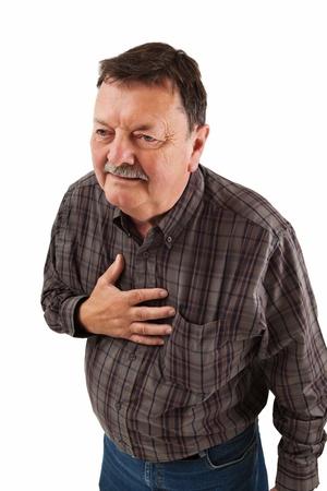 angina: Foto de un hombre de unos sesenta años con una dosis de ardor de estómago o dolores en el pecho. Foto de archivo