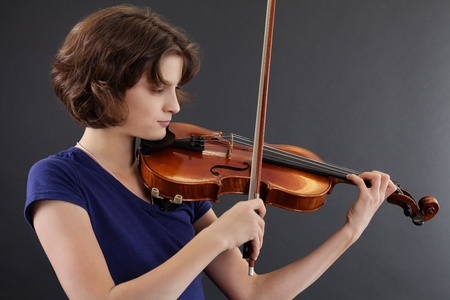 violin player: Photo of a young girl playing the violin. Stock Photo