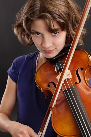 Photo of a young girl playing the violin. photo