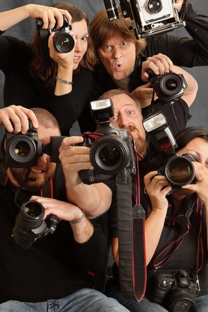 photojournalist: Photo of paparazzi fighting for space to take photos. Stock Photo