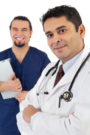 Photo of two doctors standing together smiling. Focus is on doctor on right. photo