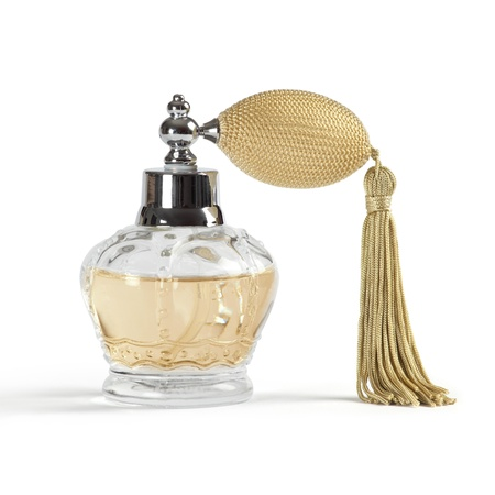 scents: Photo of a perfume spray bottle in the shape of a crown, isolated on white background.