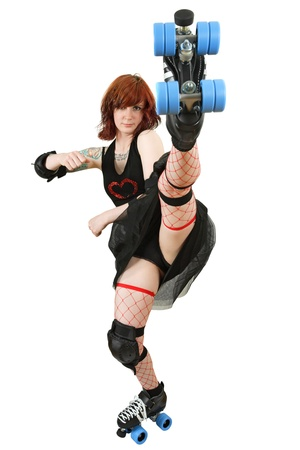 Photo of a roller derby girl kicking her skate up in the air. Isolated on white background. Stock Photo - 12343209