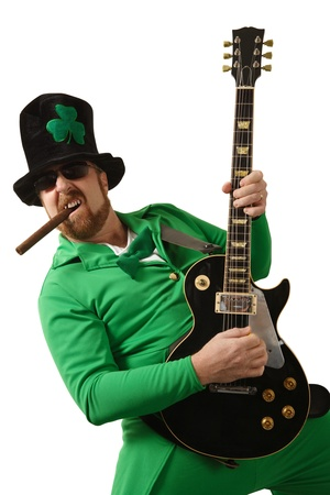 An image of a Leprechaun playing electric guitar. photo