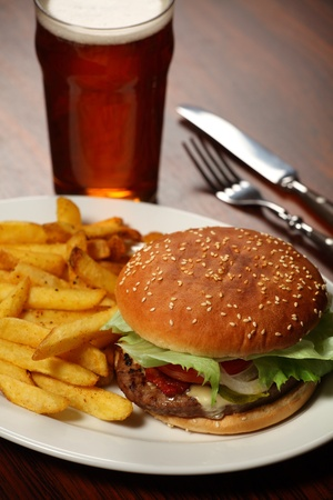 french fries plate: Photo of a burger with fries and a cold beer served at a Pub. Stock Photo