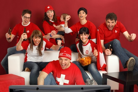 Photo of Swiss sports fans watching television and cheering for their team. Hopp Schwiiz! photo
