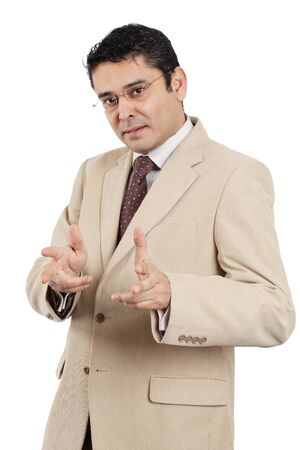late thirties: An attractive Indian businessman in his late thirties making hand gestures.