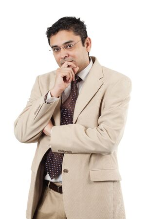 late thirties: An attractive Indian businessman in his late thirties thinking.