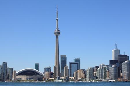 toronto: Photo of the Toronto skyline under a clear sky.
