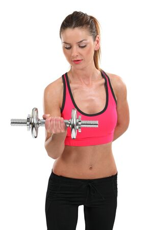 Photo of a slim female lifting a dumbbell doing bicep curls. photo