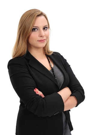 a young blond business woman standing with her arms crossed. photo