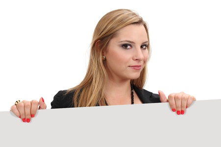 Photo of a beautiful blond female holding a blank sign - ready for your advertisement or message. Clipping path for sign and shadows included. photo